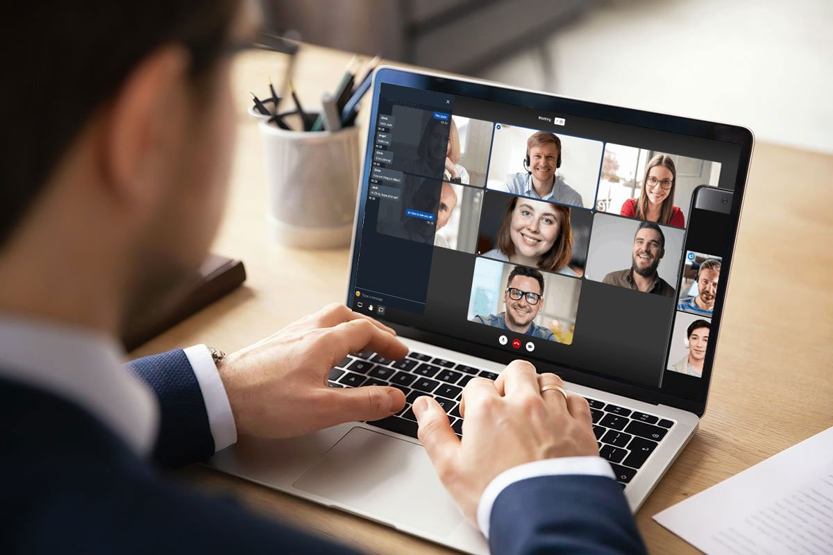 Man-using-computer-for-a-virtual-meeting-with-work-team