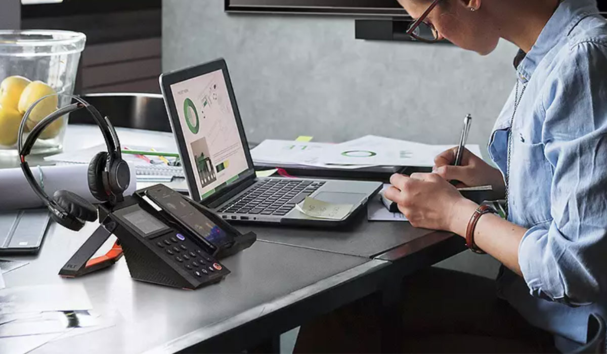 woman-working-from-home-with-polycom-vvx-phone-on-desk